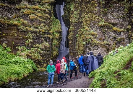 South Region, Iceland - June 9, 2018: Group Of Tourist Next To Gljufrafoss Waterfall, Close To The F
