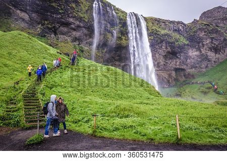 South Region, Iceland - June 9, 2018: People On The Stairs To Famous Seljalandsfoss Waterfall