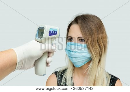 Measurement Of Womans Temperature By Infrared Non-contact Thermometer