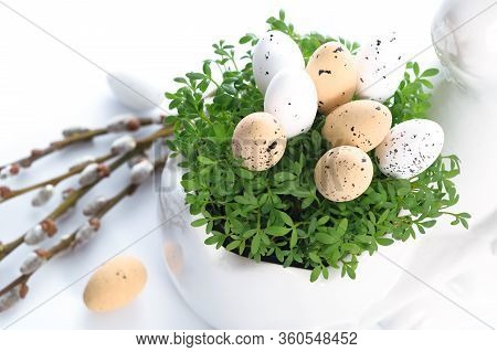 Easter Holiday Table Decoration - Eggs In Green Cress Leaves And Willow Catkins