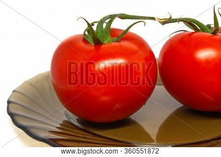 Two Bright Tomato On Slass Plate Whithout Shadow