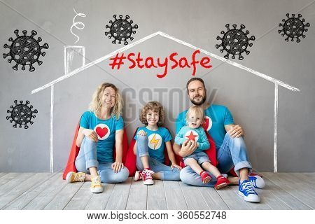 Happy Family Of Superheroes Stay At Home. Super Hero People Maintain Quarantine To Prevent Spreading