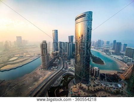 Skyline Of Al Reem Island In Abu Dhabi, United Arab Emirates At Sunset