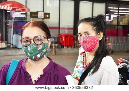 Thai Senior Mother And Young Daughter Women Wearing Fabric Mask For Social Distancing Process At Out