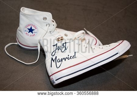 Bordeaux , Aquitaine / France - 11 07 2019 : Bride Just Married White Sneakers Converse All Star Chu