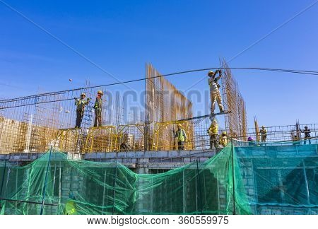 Construction Workers Work On High Rise Buildings At The Construction Site