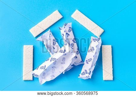 Chewing Gum On A Blue Background That Can Be Used For Lettering. Chewing Gum Is Laid Out In The Form