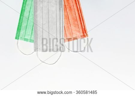 At The Top Are Masks Of Green, White And Red Colors On A Light Background. Italy Flag Made Of Medica