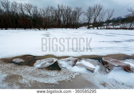 February 13 2020 Windsor, Ontario Frozen Malden Park Pond With Rock Feature