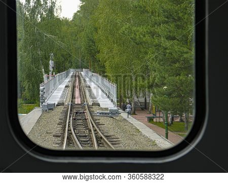 The View From The Window Of The Departing Train. The Concept Of Regret About Departure, Termination