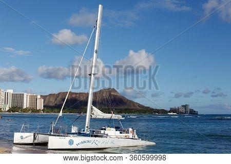 Waikiki, Hawaii - September 23, 2013: Catamaran Standing On Waikiki Beach. Diamond Head - Volcanic C