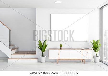 Interior Of Stylish Living Room With White Walls, Wooden Floor, Comfortable White And Wooden Cabinet