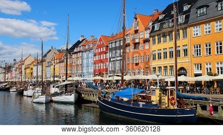 Copenhagen, Denmark - May14 2019   Nyhavn Pier With Colorful Buildings And Boats In Copenhagen, Denm