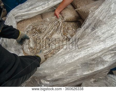 Krakovets, Ukraine - July, 2017: Border Guard Extracts Smuggled Raw Amber Stones Disguised As Fuel P