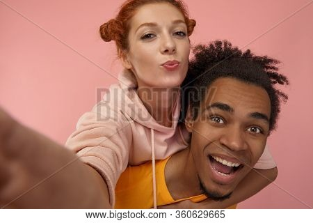 Happy Smiling Mixed-race Couple Having Fun And Taking Selfie On Smartphone Enjoy, Piggyback Ride, Lo