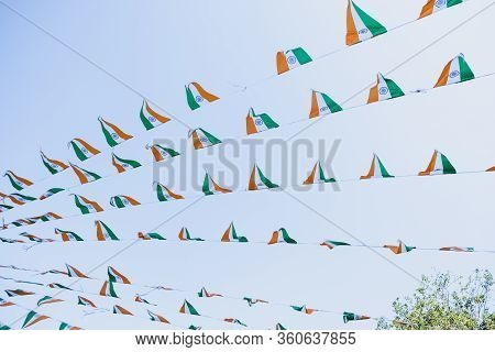 India Flags Fluttering In The Wind Agains Blue Sky