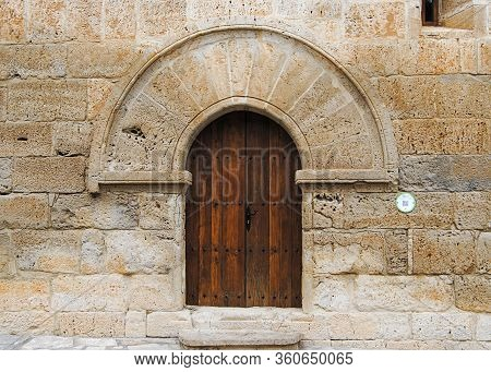 Colorful Wooden Door From An European Country. Old, Picturesque And Ancient Door.