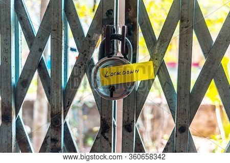 Lockdown Sticker On Door Lock Gate. Stay At Home Saying During Self-quarantine And Lockdown At Home.