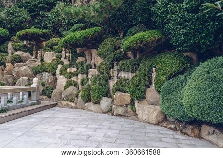 Haedong Yonggung Temple Grounds With Stone Statues Inside Landscaped Garden