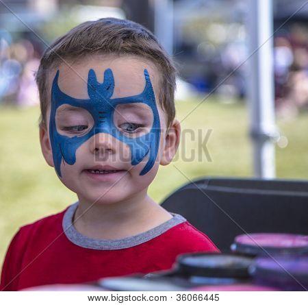 Young Boy Getting Batman Face Paint