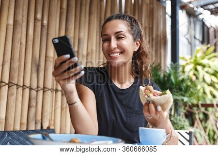 Breakfast In Restaurant, Time-management And Lifestyle Concept. Young Female Tourist, Travel Blogger