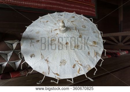 White Paper Umbrella In Traditional Lanna House, Chiang Mai, Thailand