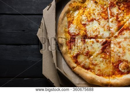 Cold Pizza In A Delivery Box, Long Delivery Times, Wasted Fast Food Concept. Italian Pizza Margherit