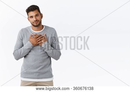 Grateful And Pleased Handsome Cute Guy In Stylish Grey Sweater, Pleased Receive Praise, Accepting Ni