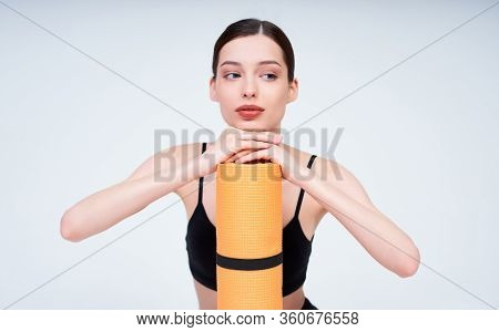 Close-up, Sympathetic Young Girl, In Black Sportswear, Practicing Yoga And Meditation, Fitness, Posi