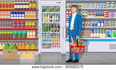 Supermarket Store Interior With Goods. Big Shopping Mall. Interior Store Inside. Customer With Baske