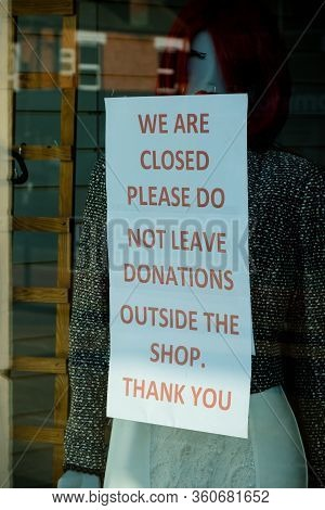 Sandhurst, United Kingdom, 9th April 2020:- A Sign Outside A Charity Shop After It Has Closed Asking