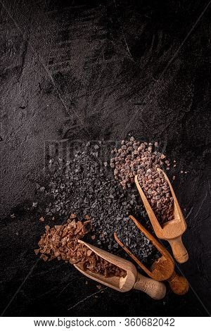 Mix Of Different Salt Types On Black Background, Flat Lay