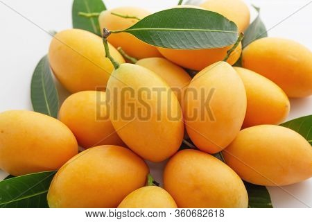 Fresh Marian Plum Or Plango Closed Up On White Table