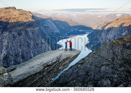 Trolltunga. Norway - 04.09.19: Happy Family On Trolltunga In Norway. Man And Girl Cuddle.