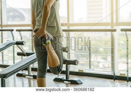 Back Side Of Woman Exercise In Gym, Crop Under Shoulder. Stretching Muscle, Stand With Leaf Leg, Rig