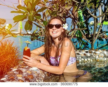 Woman With Cocktail In Pool