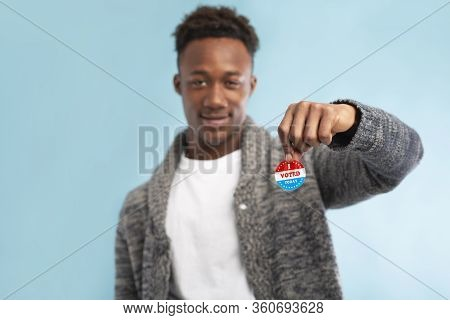 American Presidential Elections. African American Voter Holding Pin With I Voted Today Text, Blurred