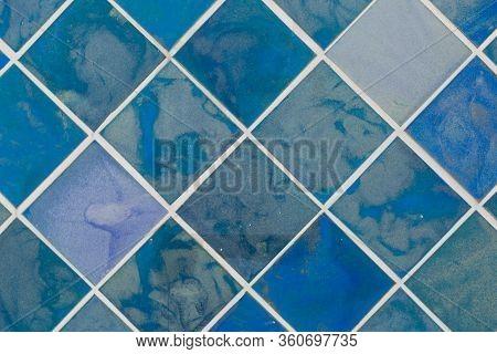Vibrant Diagonal Blue Tiles. Texuted Iles Background