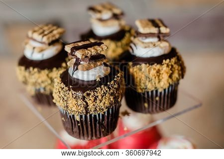 Gourmet Cupcakes On Display At Wedding Or Event