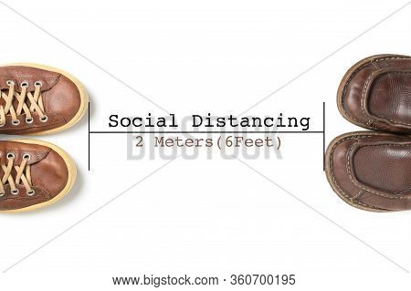 Two Leather Shoes Keep Spaced Between Each Other For Social Distancing Isolated, Concept Of Staying