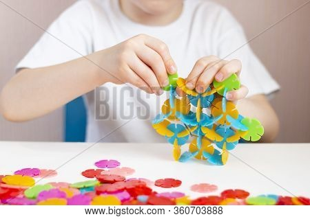 A Child Plays With A Round Colored Mosaic. Game Process Close Up. Hands Close Up. Quarantined Home A