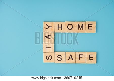 Stay home. corona infection concept. Letter of wooden blocks