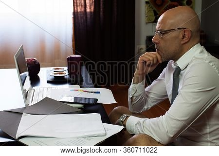 Man Teleworking At Home. Confinement Due To Coronavirus