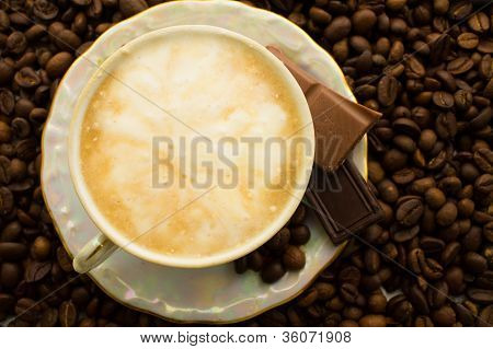 Cup Of Cappuccino On Plate