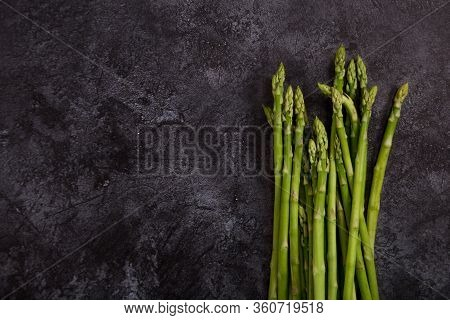 Copy Space With Asparagus At Dark Concrete Background. Frame With Copy Space With Ingredients Of Hea
