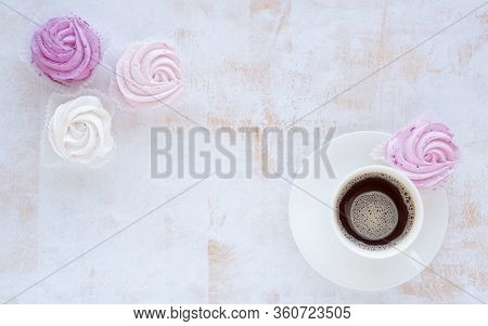 Cup Of Black Coffee With Homemade Fluffy Airy Zephyrs. Mockup For Different Ideas. Empty Place For P