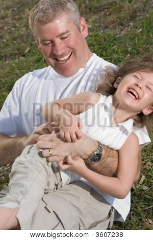 Laughing Father And Daughter