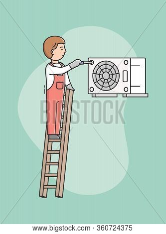 Concept Of Home Appliances Service. Man Repairs Wall Air Conditioner By Tools, Standing On Ladder. P