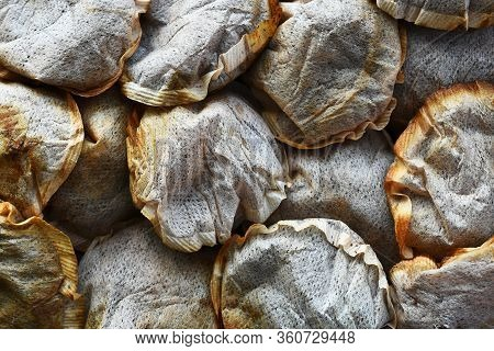 A Close Up Image Of Several Old Used Tea Bags In A Heap.