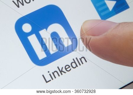Calgary, Alberta. Canada. April 11, 2020. A Person About To Open The Linkedin Application On A White